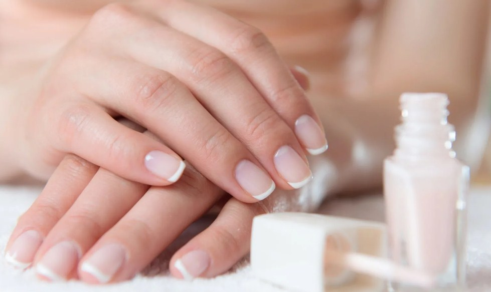 Adding a sheer pink tint french gel manicure